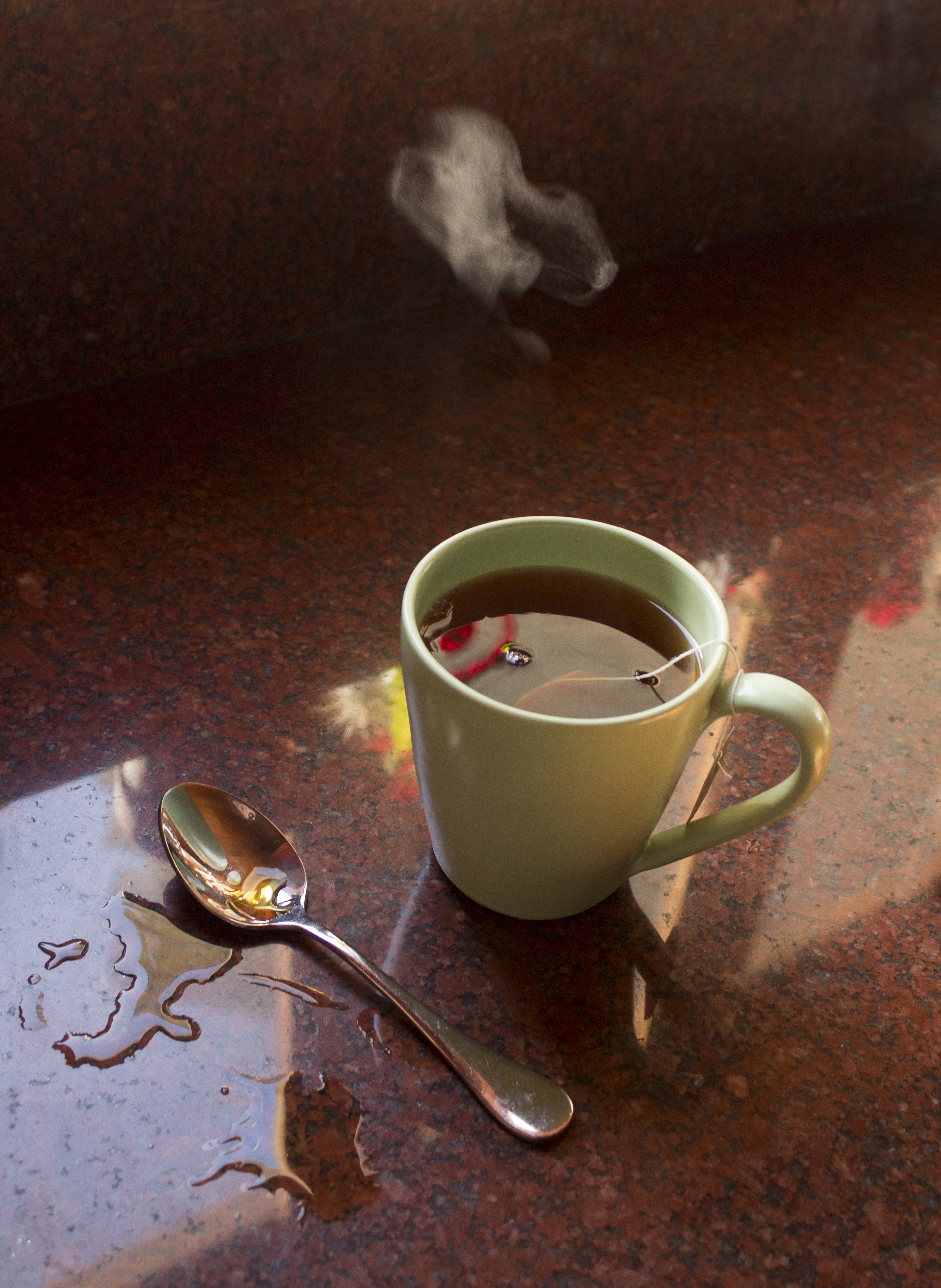 Image of steam rising from a cup of tea.