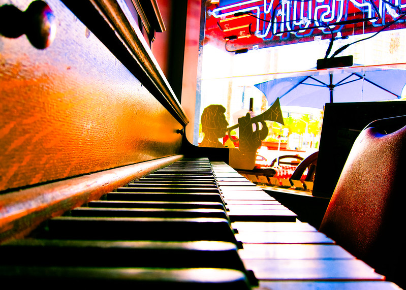 Photo of piano keys in a bar setting.