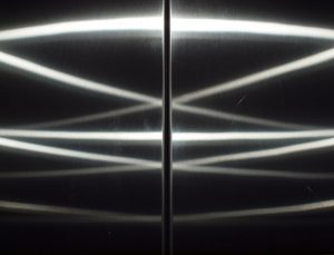 Image of light reflected on elevator doors.