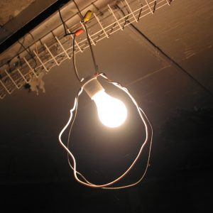 Photograph of a bulb hanging in the garage.
