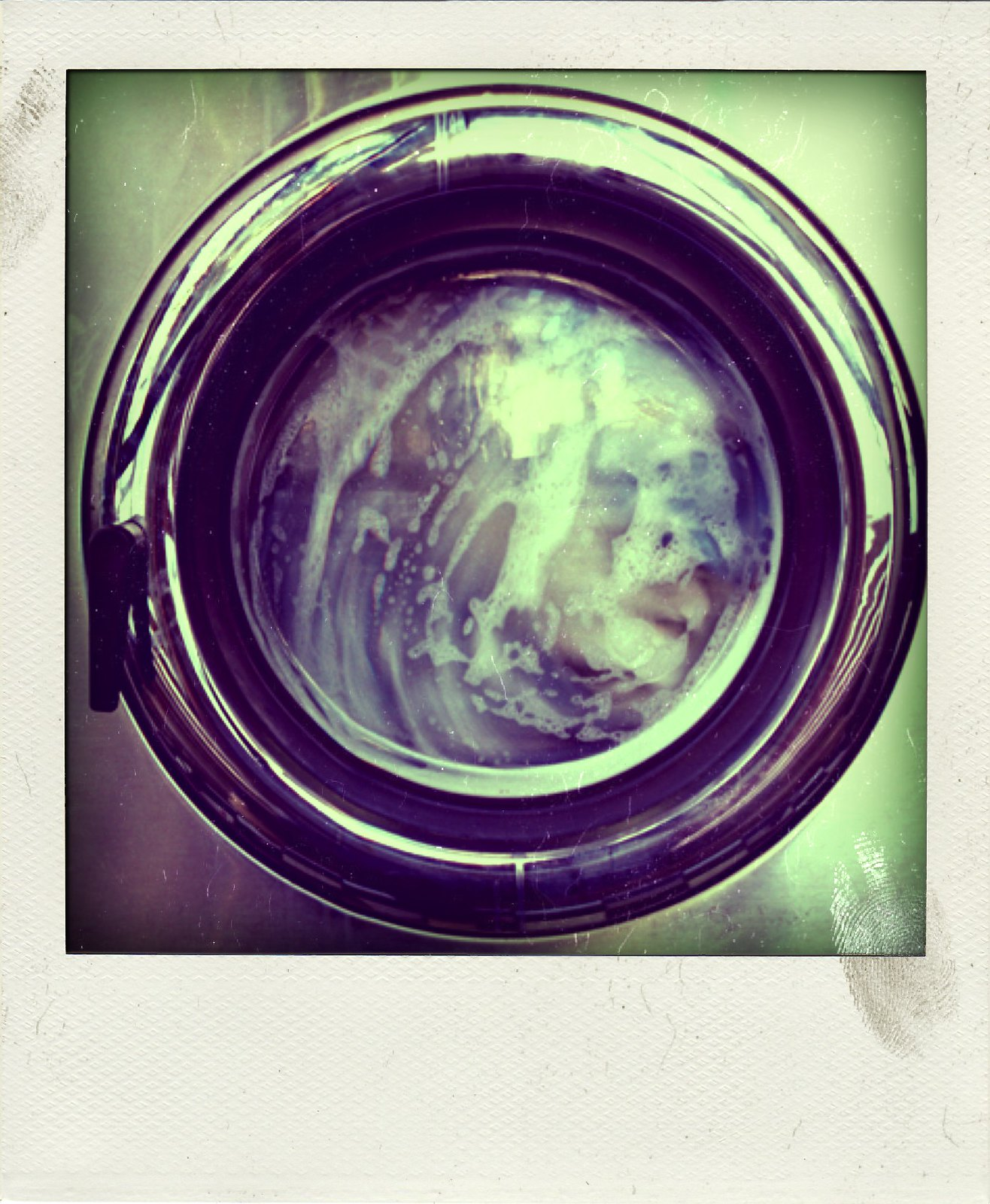 Photo of a washing machine in use.