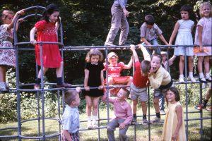 Kodachrome image of kids playing on the jungle gym.