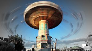 Photograph of a carnival ride in motion.