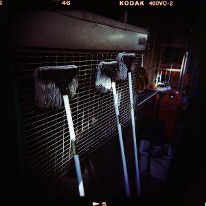 Photograph of mops at night.