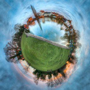 A 360-degree photo of a town neighborhood.