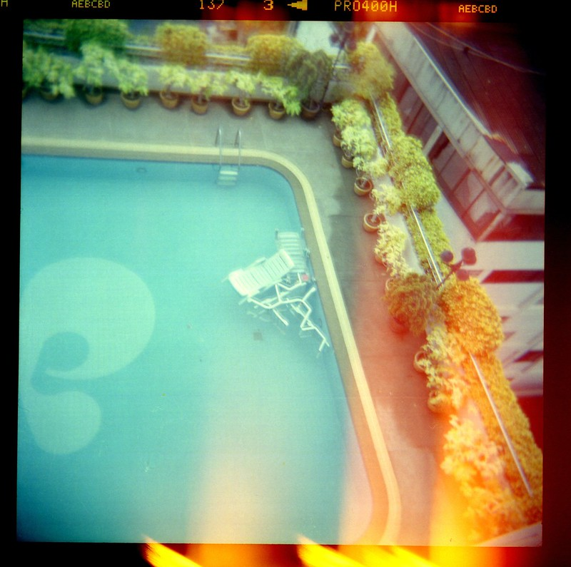 Image of chairs in a pool.
